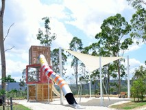 Playground tower with stainless steel slide